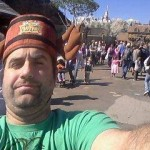 Dan Fife wearing a souvenir hat at Disney World. FantasyLand.
