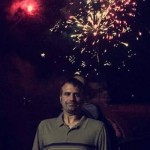 Dan Fife in front of fireworks at Weirs Beach